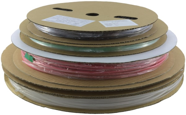 A stack of cardboard reels with different coloured heat shrink